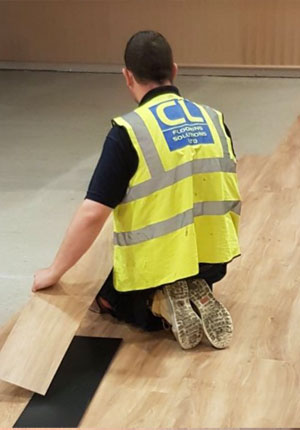 CL Flooring Worker Fitting Wooden Floor